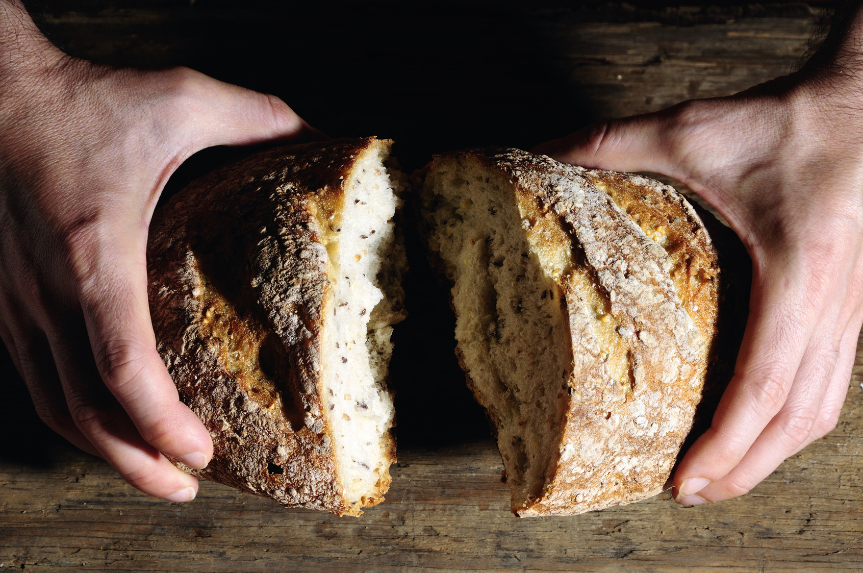 breaking a loaf of bread