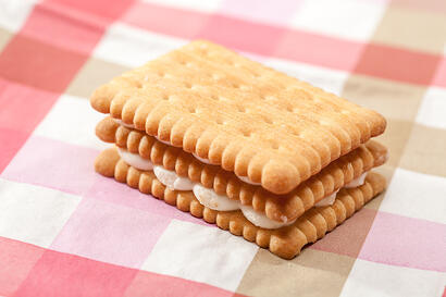 Sandwich cookie on a pink tablecloth