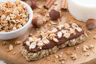 oat bar with chocolate on wooden board