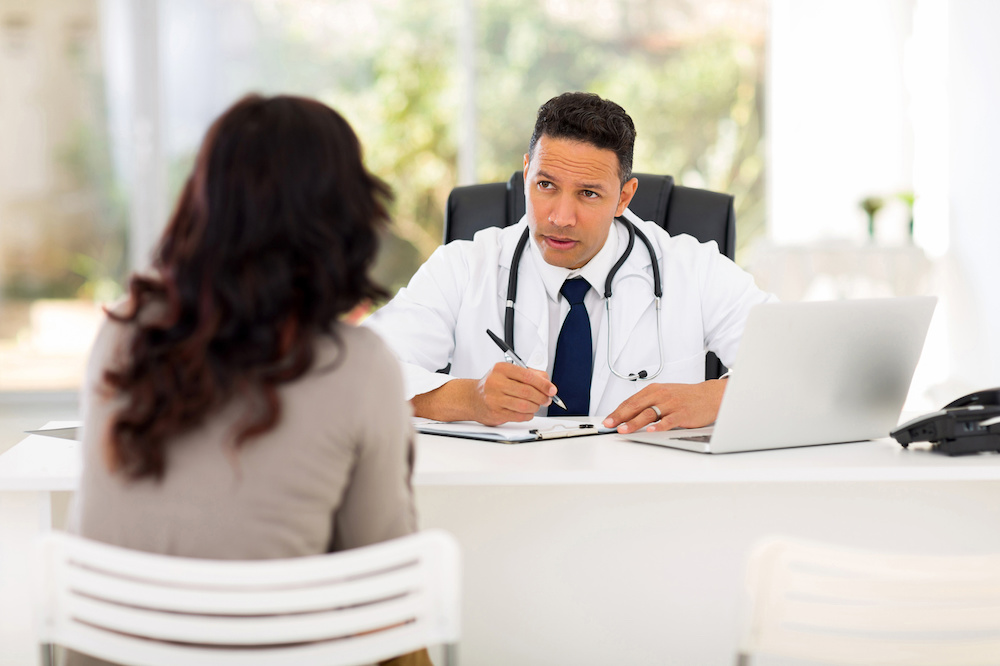 medical doctor consulting patient in office