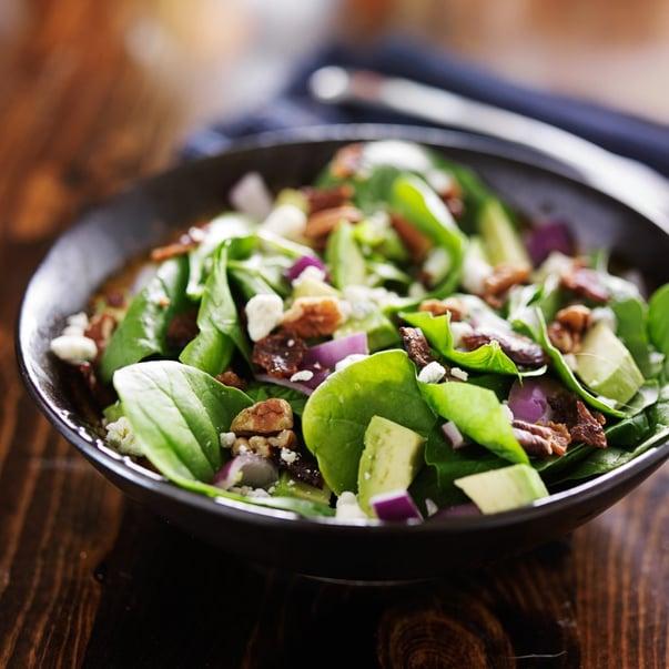 avocado spinach salad with feta cheese, pecans and bacon