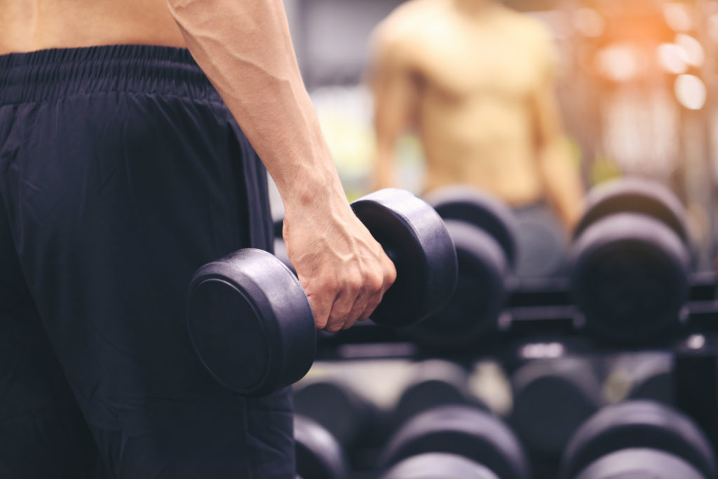 Man training hand holding dumbbells for burn fat in the body in the sport gym, Healthy lifestyle and sport concept
