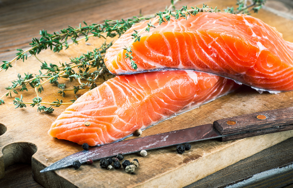 Trout and rosemary on a wooden board